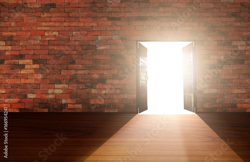 Photo Wood doors opening with old cement wall and light coming in