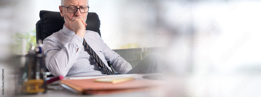 Fototapeta Portrait of thoughtful businessman sitting