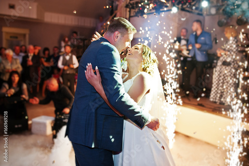 Newly married couple dancing on their wedding party with