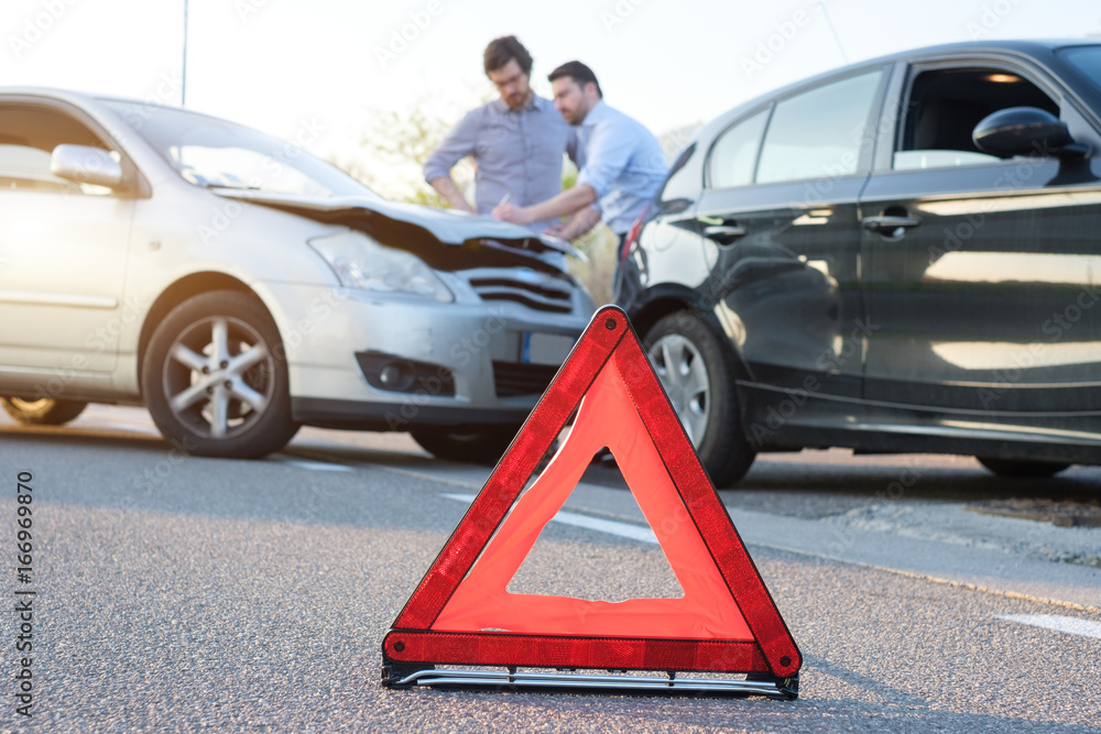 Two men reporting a car crash for insurance claim - obrazy, fototapety, plakaty
