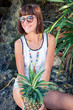 Tropical summer woman with pineapple. Outdoors, ocean, nature. Bali island paradise. Indonesia.