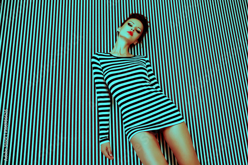 Fototapeta  fashion woman in striped dress on  background