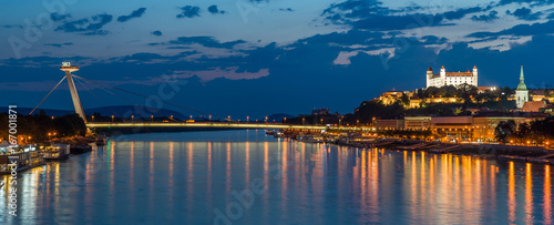 Photo  Night view on new bridge in Bratislava with castle on right side and lights reflection on river Dunaj