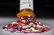 Leinwandbild Motiv A prescription pill bottle spilling out an assortment of pills