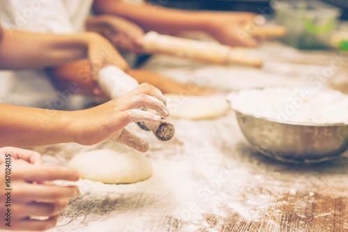 Poster Cuisine Young children make dough. Hands close up