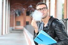 Student Smoking On Campus Clos...