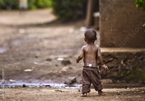 Photo Orphan boy in an impoverished African village.