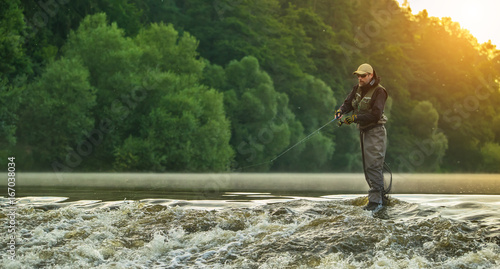 Sport fisherman hunting fish. Outdoor fishing in river