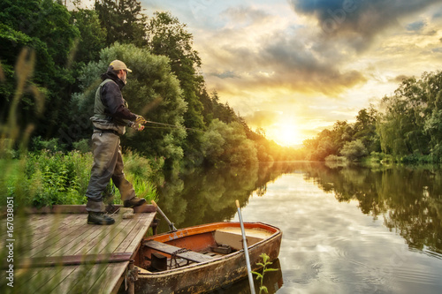 Fotobehang Vissen Sport fisherman hunting fish. Outdoor fishing in river