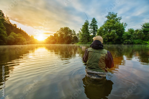 Printed kitchen splashbacks Fishing Sport fisherman hunting fish. Outdoor fishing in river