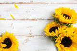 Fototapeta Flowers - Yellow Sunflower Bouquet on White Rustic Background