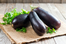 Fresh Eggplant On Wooden Backg...