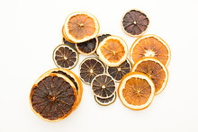Pile Of Dried Citrus Circles Lying On White Table
