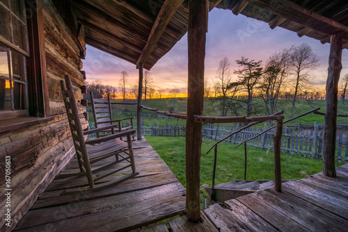 Fotografiet  old worn porch with rocking chairs at sunset, appalachian mountains