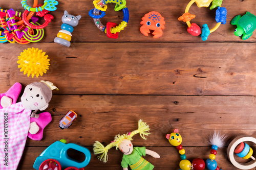 Obraz group of baby toys on wooden background with copy space. top view - fototapety do salonu