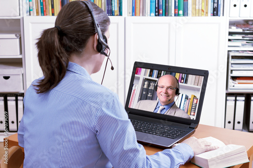 woman headset teacher online lesson