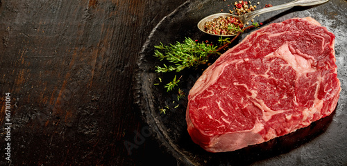 Recess Fitting Steakhouse Piece of raw rib eye steak