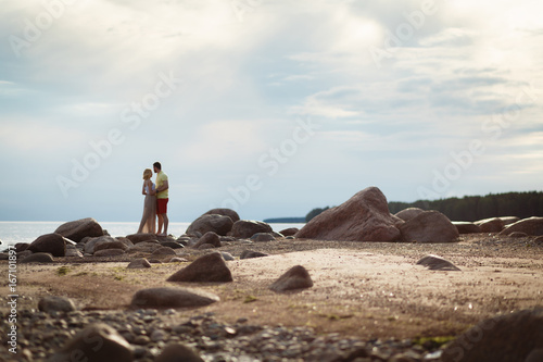 Foto op Canvas Schapen Couple walking on the beach. Young happy interracial couple walking on beach smiling holding around each other. Enjoy the sunset and each other at sunset with clouds