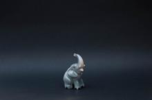 Porcelain Elephant Figurine On...