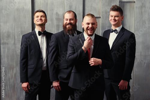 Photo Group of handsome elegant young men in tuxedo.