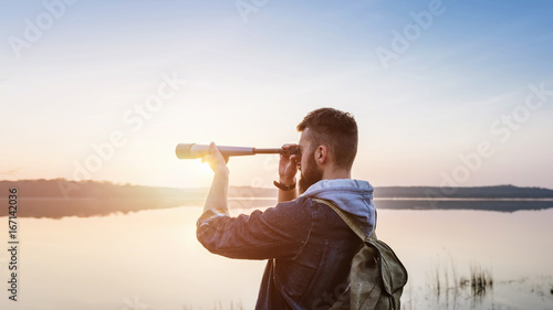 Fototapeta A guy with a telescope for nature... obraz