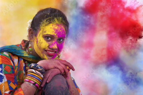 Portrait of  young Indian Woman celebrating Holi color festival Poster