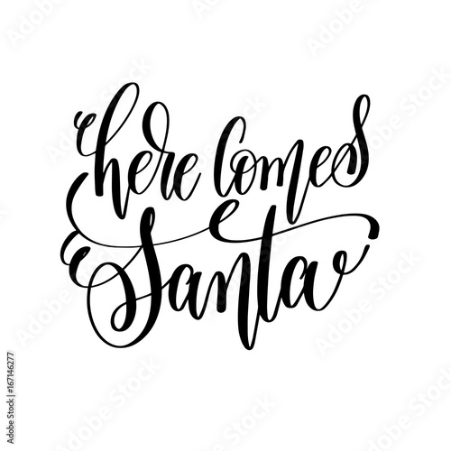 Photo  here comes santa hand lettering inscription to winter holiday