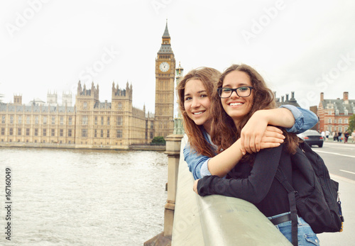 Photo sur Toile Londres Two teenage girls on Big Ben background