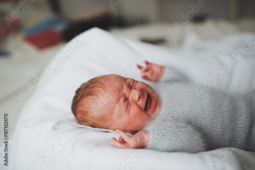 sweet newborn crying baby