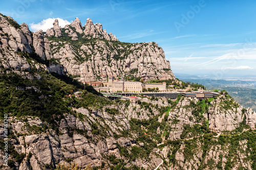 Photo  Santa Maria de Montserrat abbey in Montserrat mountains near Barcelona, Spain