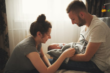 Mother And Father With Newborn...