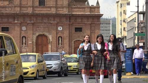 Photo  Female Students Walking Home From School