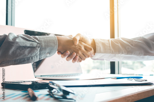 Business people accept or confirm project on the proposal and join shaking hands at office room company Canvas Print