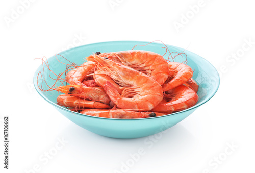Fresh cooked shrimp on a plate isolated on white background.