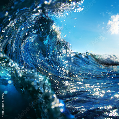 shorebreak with swirled ocean wave Wall mural