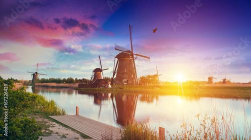 Poster Prune Warm and cloudy sunset on the Kinderdijk, UNESCO world heritage site, Alblasserdam, Netherlands