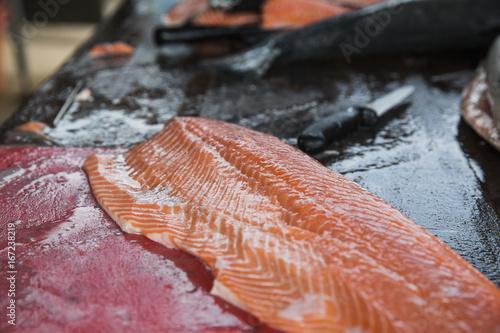 Closeup of fresh salmon fillet on a cutting board