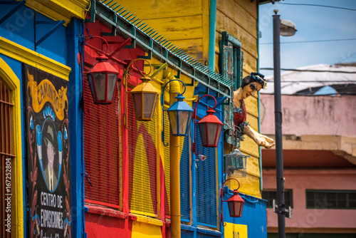Spoed Foto op Canvas Buenos Aires Street iron lanterns are painted in different colors. Shevelev.
