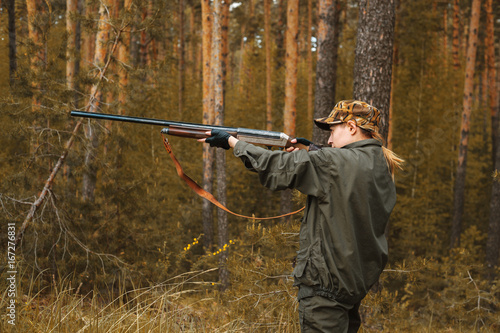 Fotobehang Jacht Woman hunter in the woods. Autumn hunting season. Hunting Conceptual background. Outdoor sports.