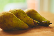 A Close Up Of Three Ripe Pears...