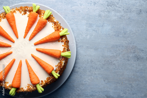 Plate with delicious carrot cake on grey table Wallpaper Mural