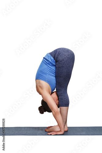 Woman doing yoga asana Uttanasana - standing forward bend Canvas Print