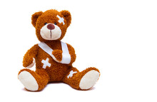 Injured Teddy Bear On White Ba...