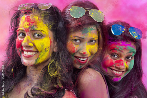 Portrait Of Three Young Indian Women With Colored Face celebrating Holi Color fe Wallpaper Mural