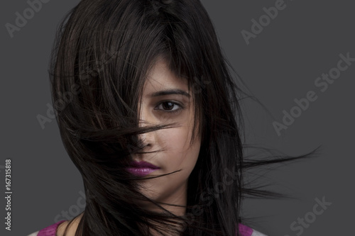 Fotografering Hair covering half of a woman's face