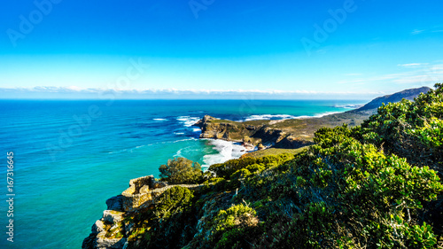 Fotografija  Rugged coastline and steep cliffs of Cape of Good Hope on the Atlantic Ocean sid