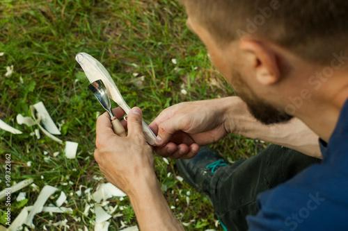 muscular middle eastern man wearing creative cup focused on work, while creating Fototapeta