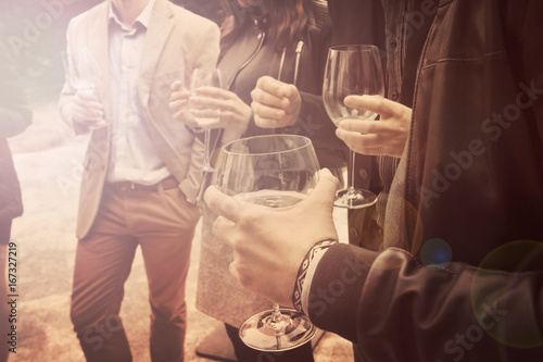people is drinking wine vintage effect, a group of friends is socializing and ha Poster