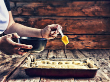 Preparation Of A Homemade Cake Or Bakery, Fresh Pastry, Greases The Cake With An Egg
