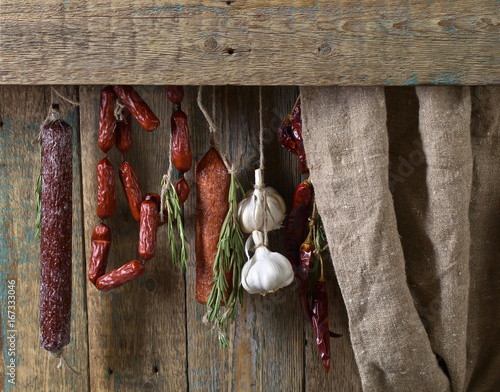 Sausages with rosemary , garlic and pepper. Poster